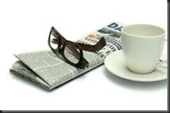 newspaper, cup, glasses